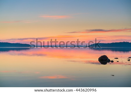 Twilight sunset view of the Scandinavian Baltic Sea and Swedish Archipelago with rocks in the sea. Shot during mid summer festival #443620996