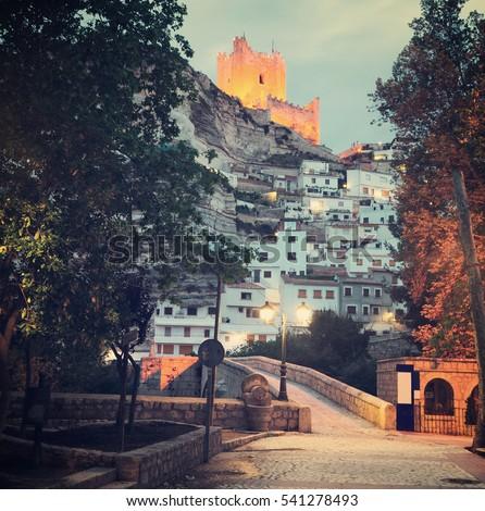 twilight view of Alcala del Jucar with  castle and bridge. Province of Albacete, Spain