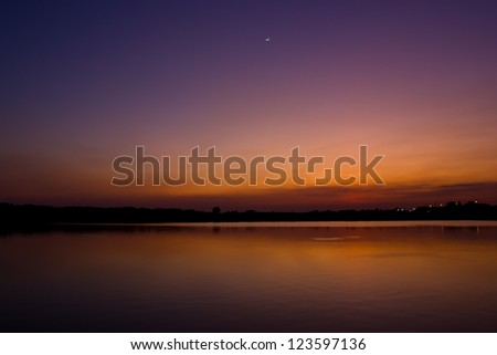 twilight with moon reflect water