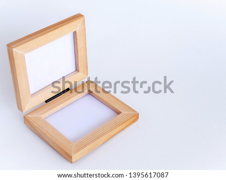 Twin blank picture fame with black hinge, Bi-fold wooden photo frame on white background with clipping path. Isomatric view from top.