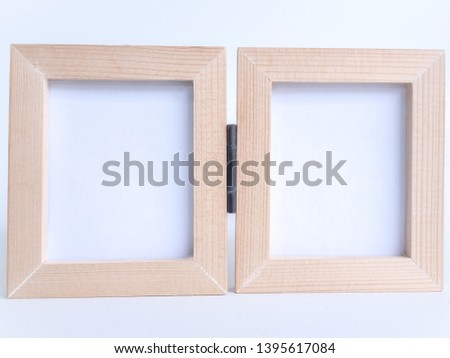 Twin blank picture fame with old hinge, Bi-fold wooden photo frame on white background with clipping path.