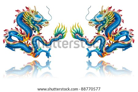 Twin blue dragon statues on white background with reflection