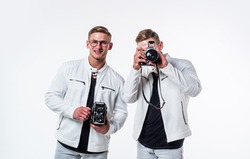 twin brothers men photographer in white casual look alike use vintage photo camera, photographing.