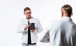 twin brothers men photographer in white casual look alike use vintage photo camera, photographing