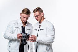 twin brothers men photographer in white casual look alike use vintage photo camera, photography.