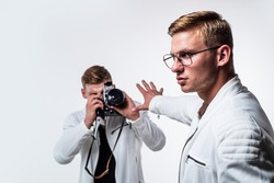 twin brothers men photographer look alike use vintage photo camera, paparazzi and private data
