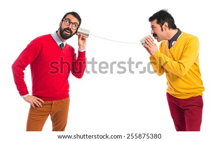 Twin brothers talking through a tin phone