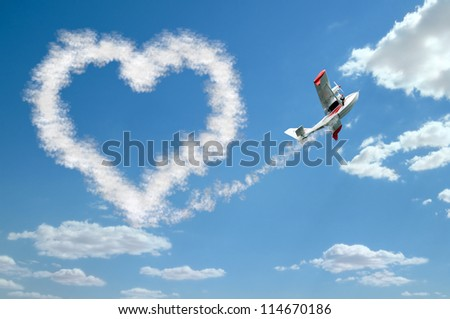 twin-engine hydroplane flight in sky and draw white heart of  clouds