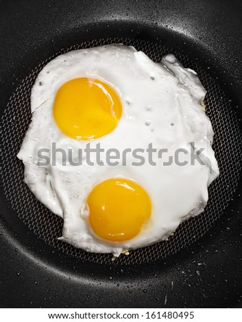 twin fried eggs on the pan