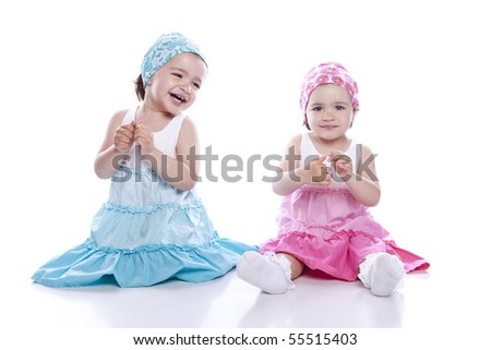 stock photo : Twin Girls sitting on white background