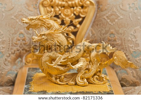 Twin Golden dragon statue in chinese temple, Thailand