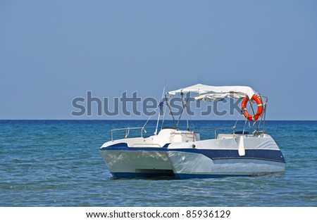 twin hull or catamaran style speedboat or ski boat on the greek island of zakynthos on a beautiful sunny day at the beach.