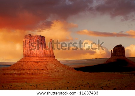 stock-photo-twin-peaks-of-rock-formations-in-the-navajo-park-of-monument-valley-utah-known-as-the-mittens-11637433.jpg