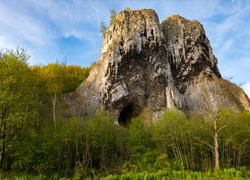 "Twin rocks called ""Pater und Nonne"" (Father and Nun) near Iserlohn-Letmathe Sauerland Germany in the lenne valley with a cave orifice that was used by early men as shelter on a sunny spring evening"