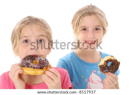 twin sisters eating a doughnut