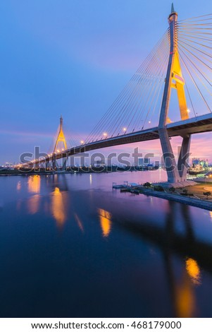 Twin suspension Bridge cross river with twilight sky background, Bangkok Thailand #468179000