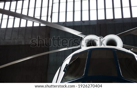 Twin-turbine helicopter is in the hangar. Rotor blades, turbines and cockpit. Selective focus.  Foto d'archivio ©