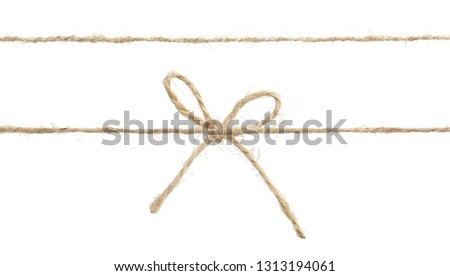 Twine rope with bow isolated.Package decor. #1313194061
