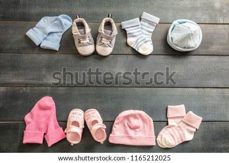 f435f45fa6bce Twins babies shower concept. Baby boy and girl shoes and socks on blue  wooden background