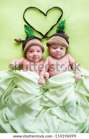 twins brothers babies wear acorn hats