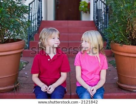 Twins on stoop - stock photo