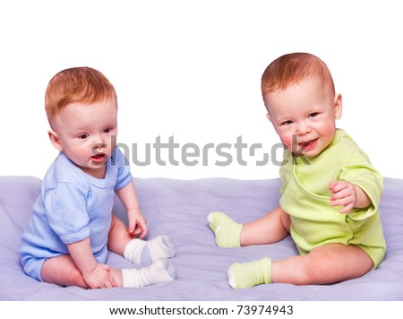 Twins sit the friend opposite to friend