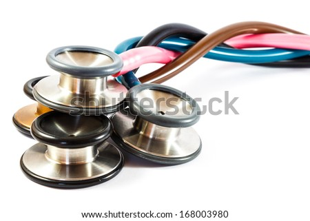 twist colorful stethoscopes on white background(isolated) and blank area at right side