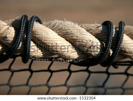 Twisted beige rope with black ties