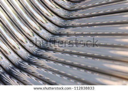 Twisted chrome pipes abstract pattern background