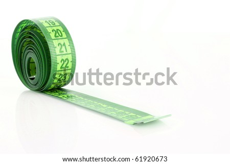 Twisted green measuring  tape isolated on white
