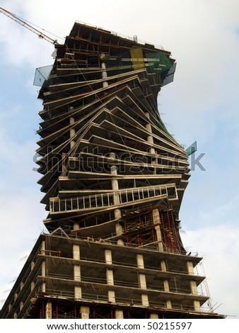 twisted sky scraper under construction in Latin America.  This height of this now completed building is 210 M