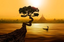 Twisted tree in front of lake and Buddhist temple in Bagan