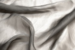 Twisted twirl of organza fabric gray texture