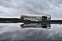 Twisted wreckage from an airplane crash in Iceland on Solheimasandur black sand beach