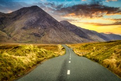Twisty road in Connemara Moutains at sunset, Ireland