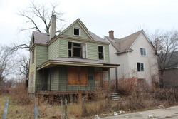 Two abanoned large  homes in Chicago's South Side Englewood neighborhood