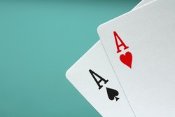 Two Ace playing cards on blue background