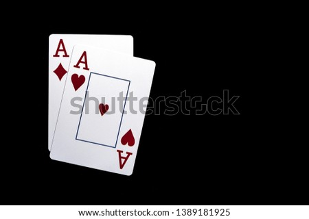 Two aces, playing cards on black table. Casino, gambling game chance concept #1389181925