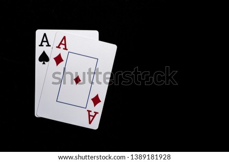 Two aces, playing cards on black table. Casino, gambling game chance concept #1389181928