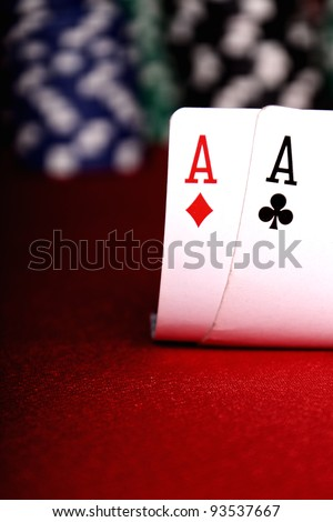 two aces with blurry chips and background