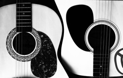 Two acoustic guitars in the form of yin-yang