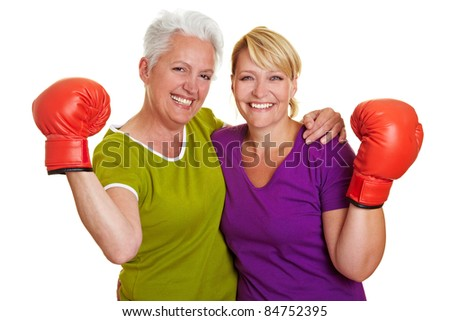 Two active senior women with red boxing gloves