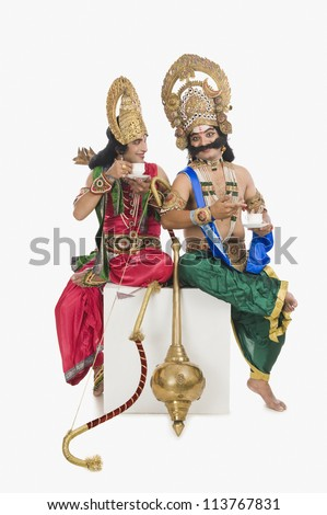 Two actor dressed-up as Rama and Ravana and drinking tea