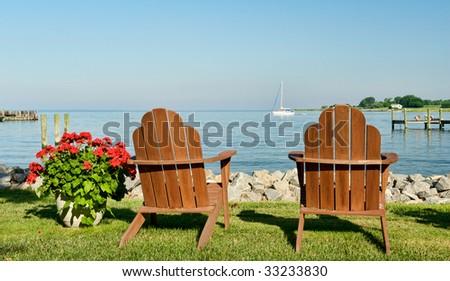 Two Adirondack Chairs on Coast