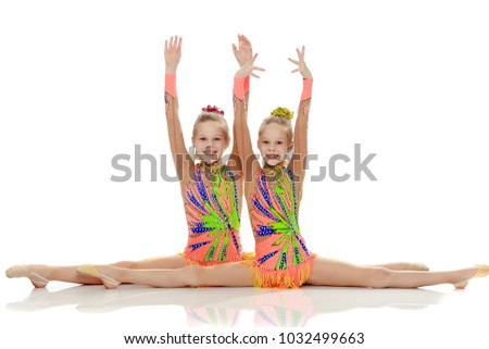 Young girl doing the splits stretching Images and Stock