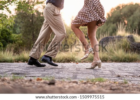 Two adult dancers feet dancing swing music outdoors in the park - unrecognizable people #1509975515