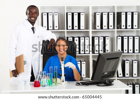 two african american scientists in lab