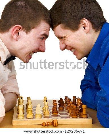 Two aggressive chess opponents fights with his forehead under chess board
