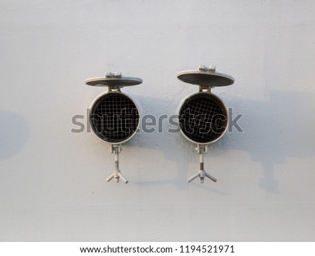 Two air intakes that can be closed on a bulkhead of a ship