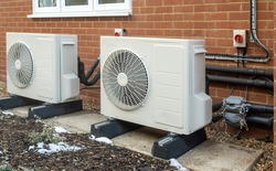 Two air source heat pump units installed on a modern house